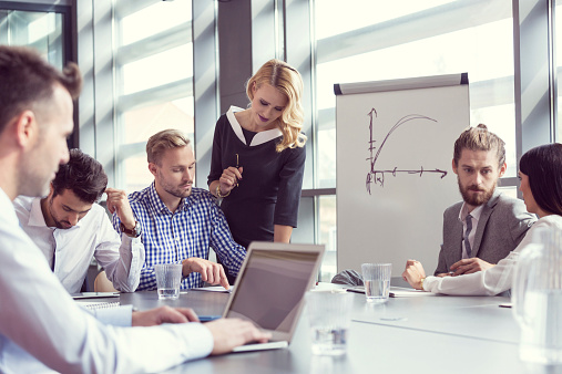 Business Team Having Meeting In An Office Stock Photo - Download Image Now