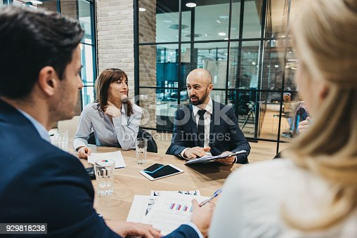 925942192istockphoto Business team having meeting in an office 929818238
