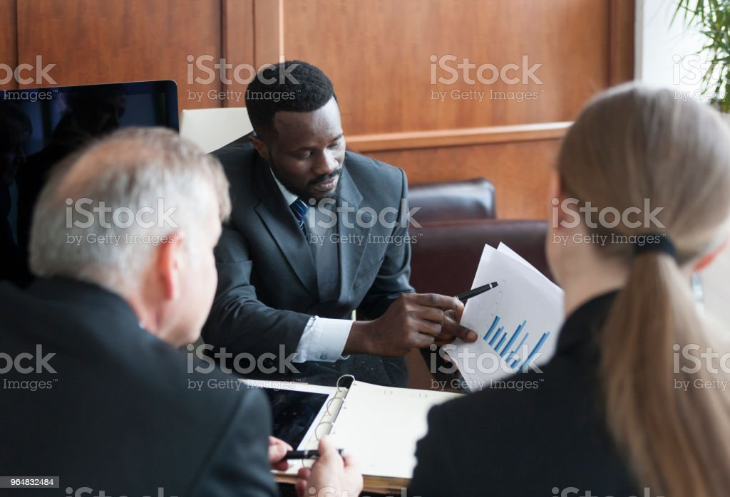 Business team having meeting in an office royalty-free stock photo