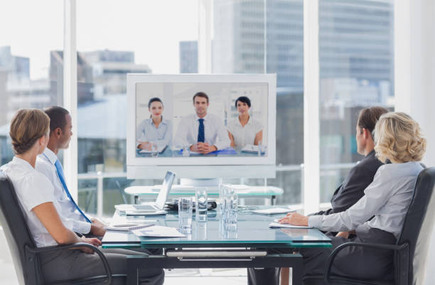 Business team having video conference stock photo