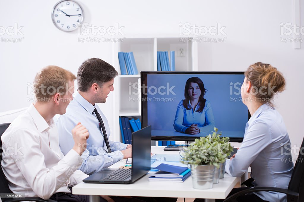 Business team having web conference stock photo
