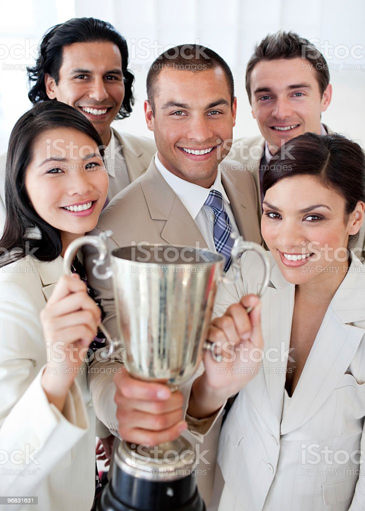 Business team holding a trophy royalty-free stock photo