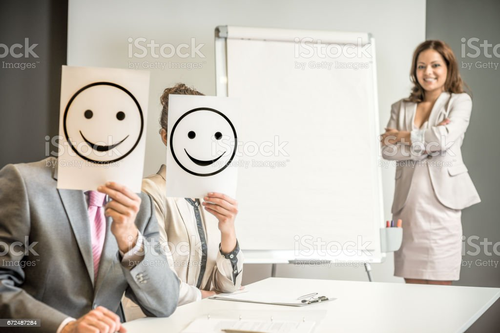 Business team holding happy smile sign stock photo