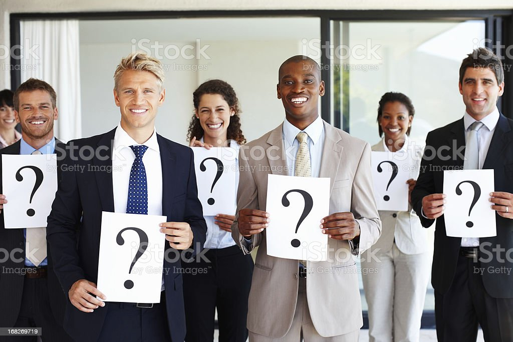 Business team holding question mark signs royalty-free stock photo