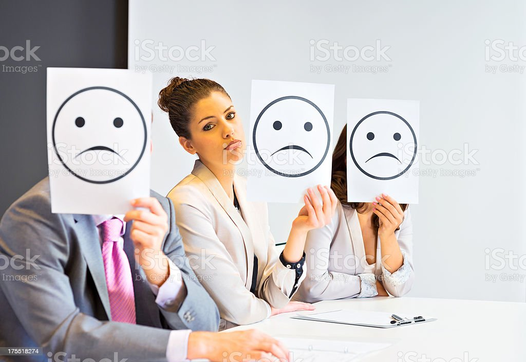 Business team holding sad signs royalty-free stock photo