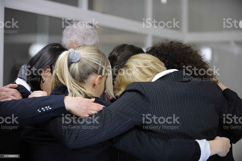 Business team huddled together stock photo