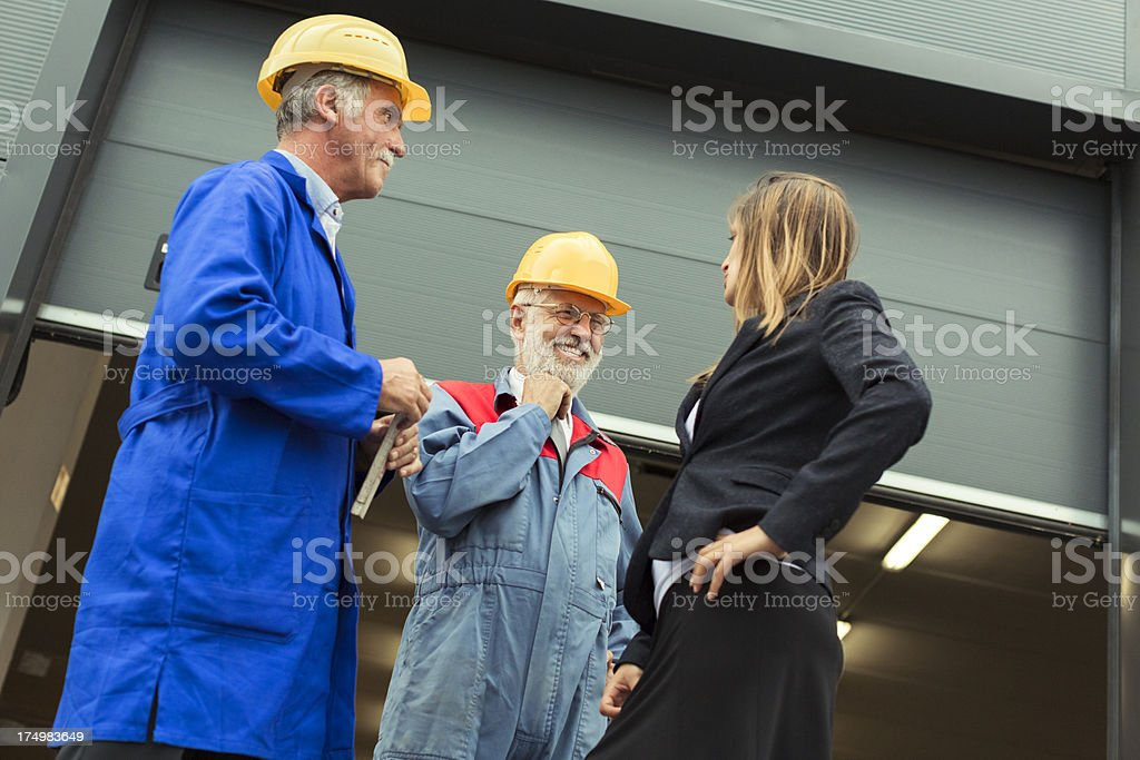 Business team in front of warehouse entrance royalty-free stock photo