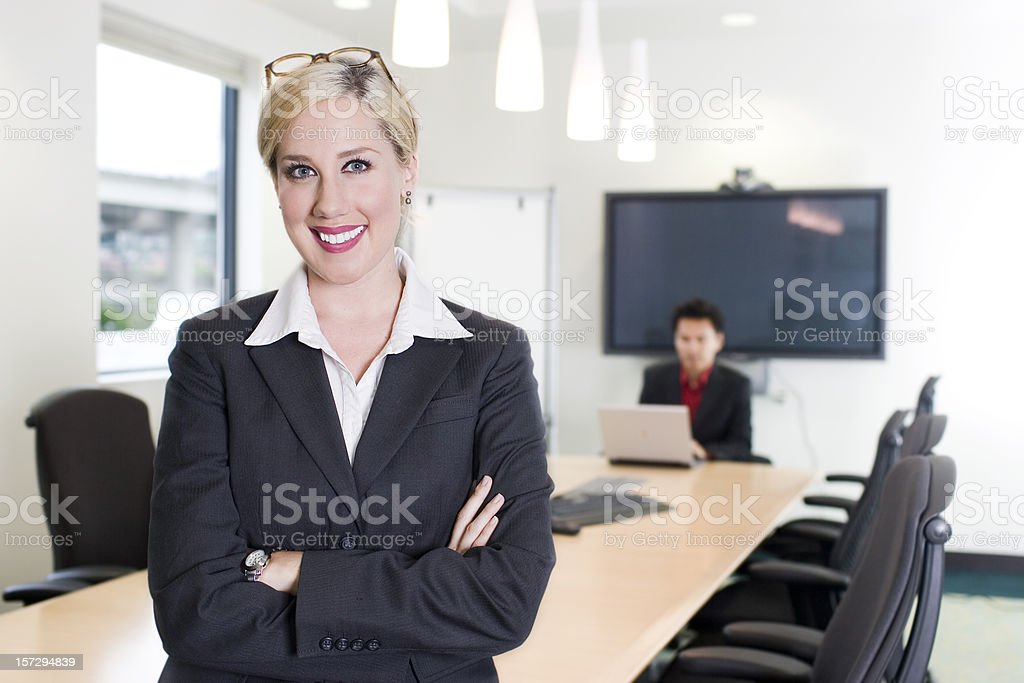 Business Team in Office Conference Room with Arms Crossed royalty-free stock photo