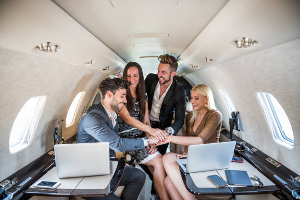 Business team in private jet airplane stock photo