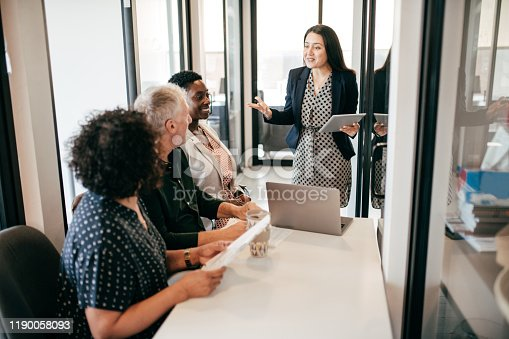 975599364istockphoto Business team in the office 1190058093