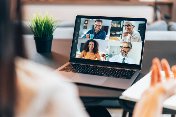 Business team in video conference Modern Multiethnic business team having discussion and online meeting in video call video call stock pictures, royalty-free photos & images
