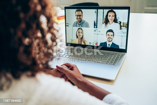 African-american businesswoman talking to her colleagues about business plan in video conference. Multi-ethnic business team using laptop for a online meeting in video call. Young woman working at home. Unrecognizable businesswoman discussing with colleagues with video call. Shot of a business person using a laptop for web conference.