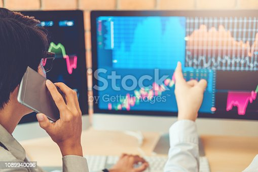 1131299321 istock photo Business Team Investment Entrepreneur Trading discussing and analysis graph stock market trading,stock chart concept 1089940096
