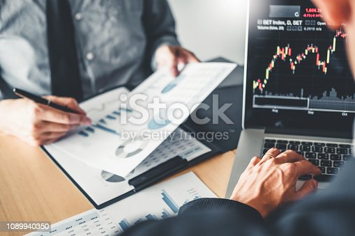 1131299321 istock photo Business Team Investment Entrepreneur Trading discussing and analysis graph stock market trading,stock chart concept 1089940350
