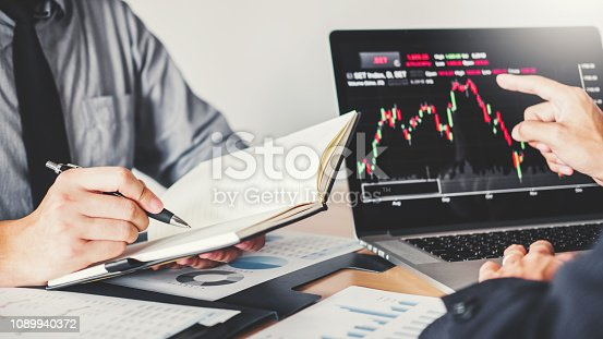 1131299321 istock photo Business Team Investment Entrepreneur Trading discussing and analysis graph stock market trading,stock chart concept 1089940372