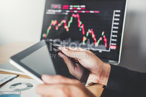 1131299321 istock photo Business Team Investment Entrepreneur Trading discussing and analysis graph stock market trading,stock chart concept 1089940382