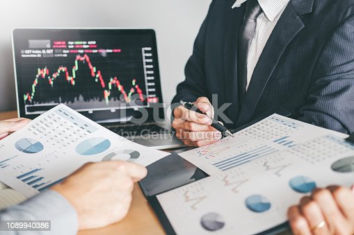 1131299321 istock photo Business Team Investment Entrepreneur Trading discussing and analysis graph stock market trading,stock chart concept 1089940386