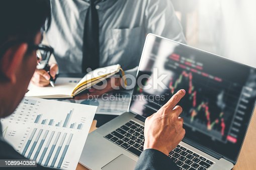 1131299321 istock photo Business Team Investment Entrepreneur Trading discussing and analysis graph stock market trading,stock chart concept 1089940388