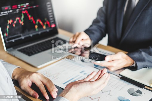 1131299321 istock photo Business Team Investment Entrepreneur Trading discussing and analysis graph stock market trading,stock chart concept 1089940416