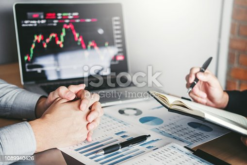 1131299321 istock photo Business Team Investment Entrepreneur Trading discussing and analysis graph stock market trading,stock chart concept 1089940426