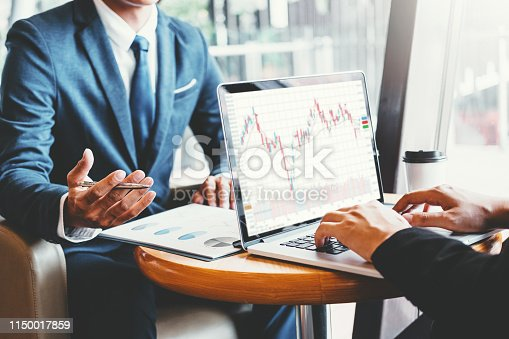 1131299321 istock photo Business Team Investment Entrepreneur Trading discussing and analysis graph stock market trading,stock chart concept 1150017859