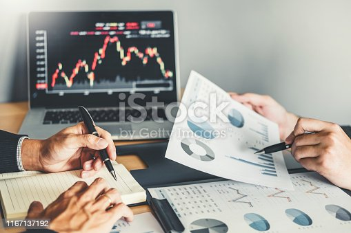 1131299321 istock photo Business Team Investment Entrepreneur Trading discussing and analysis graph stock market trading,stock chart concept 1167137192