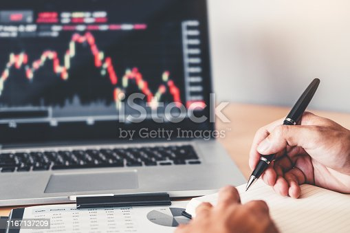 1131299321 istock photo Business Team Investment Entrepreneur Trading discussing and analysis graph stock market trading,stock chart concept 1167137209