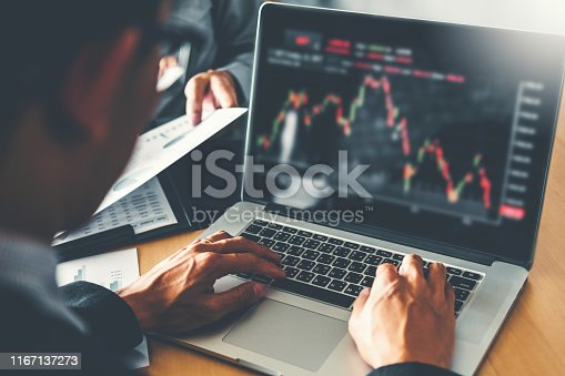 1131299321 istock photo Business Team Investment Entrepreneur Trading discussing and analysis graph stock market trading,stock chart concept 1167137273