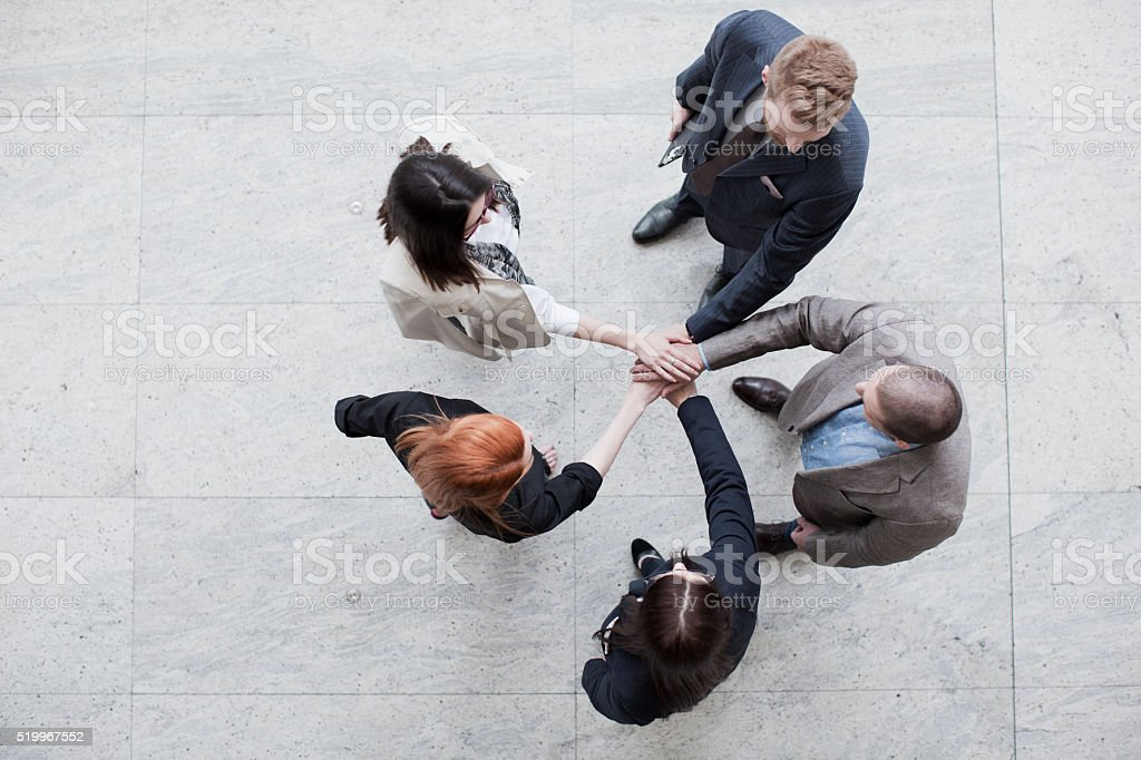 Business team joining hands stock photo