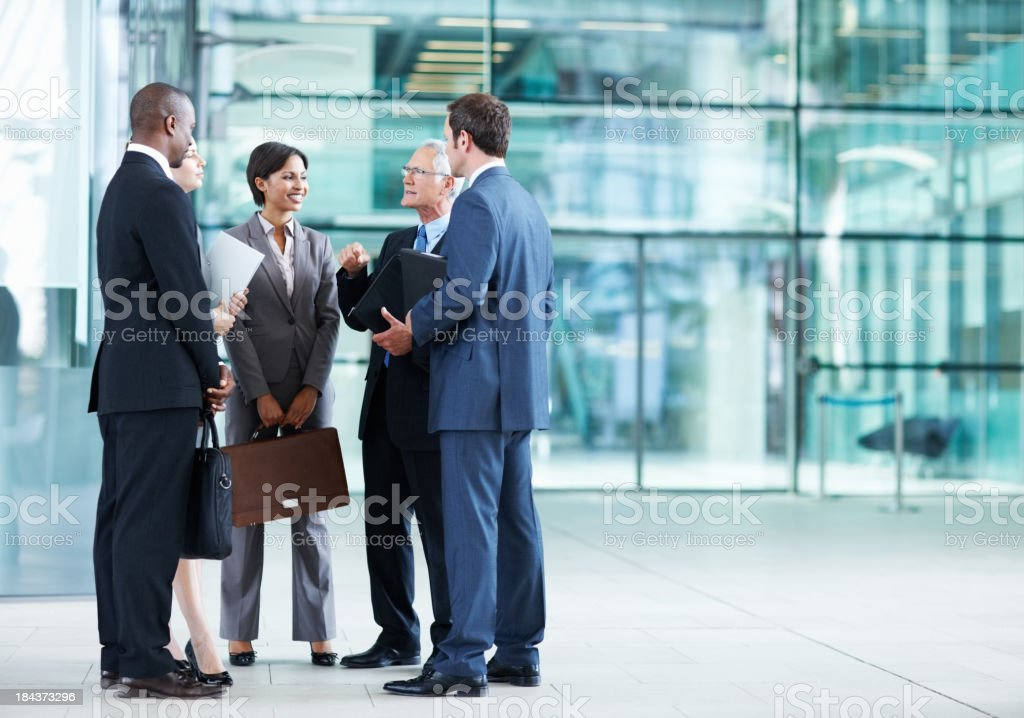 Business team listening to their leader royalty-free stock photo