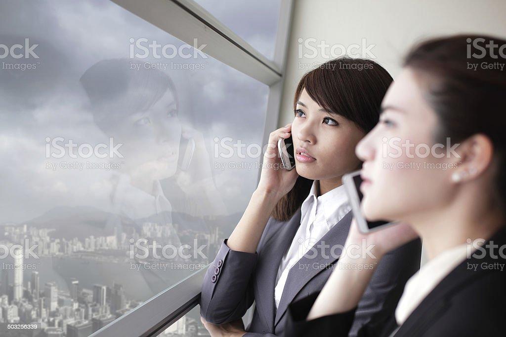 Business team look city through window stock photo