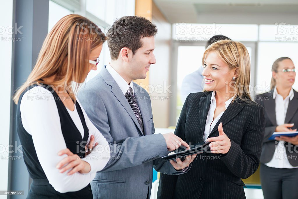 Business Team Looking at a Tablet Computer royalty-free stock photo