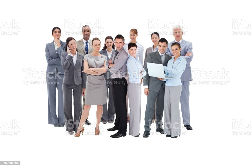 Business team looking at camera stock photo