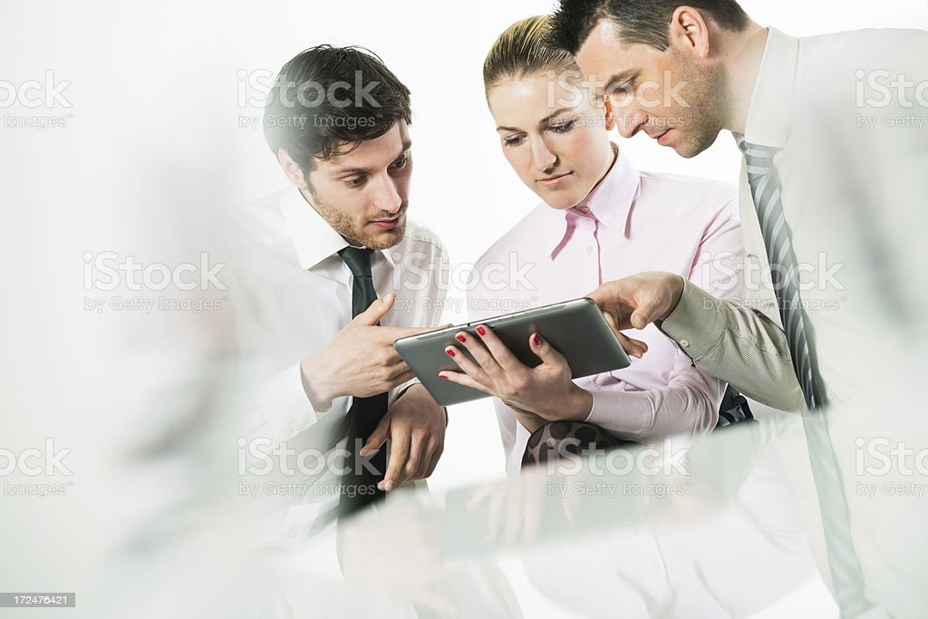 Business team looking at tablet royalty-free stock photo