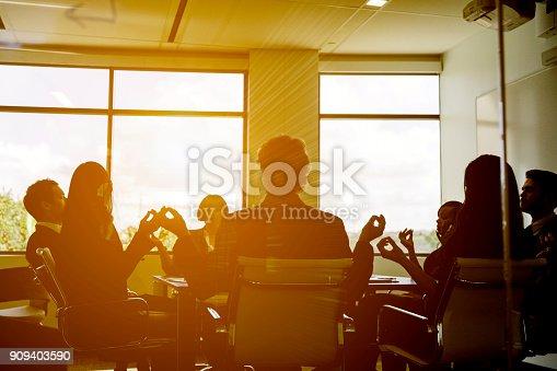 istock Business Team Meditating 909403590