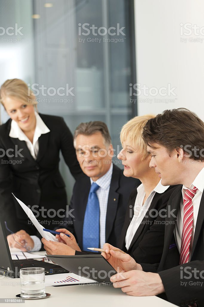Business team meeting in an office setting royalty-free stock photo