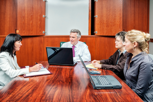 672116416 istock photo Business Team Meeting in Boardroom 174989876