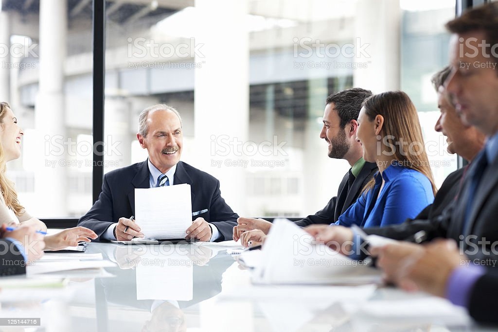 Business Team Meeting in Glass Boardroom, Copy Space royalty-free stock photo