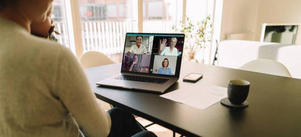 Business team meeting online over a video conference stock photo
