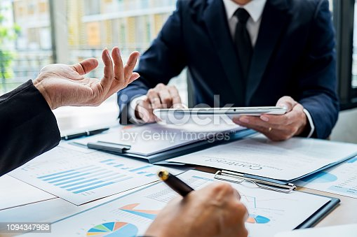 954578184 istock photo Business team meeting present. Professional investor working with new startup project. Digital tablet laptop computer design smart phone in office. 1094347968