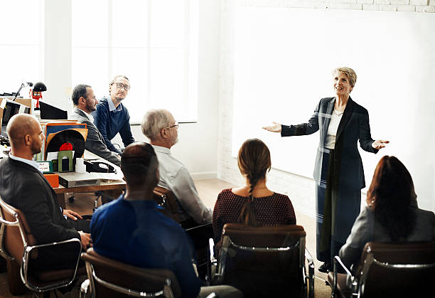 Business Team Meeting Seminar Conference Concept Business Team Meeting Seminar Conference Concept presenter stock pictures, royalty-free photos & images