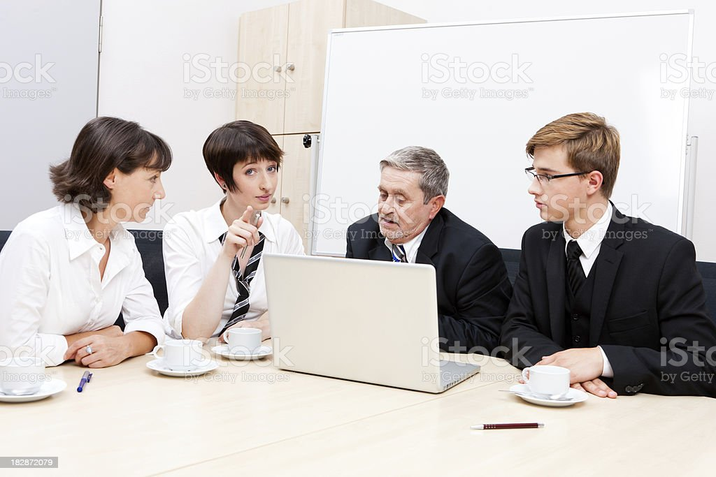 Business Team Meeting With Laptop And Coffee Stock Photo