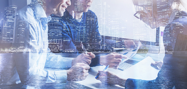 istock business team of coworkers working on startup in office, double exposure 1068812244