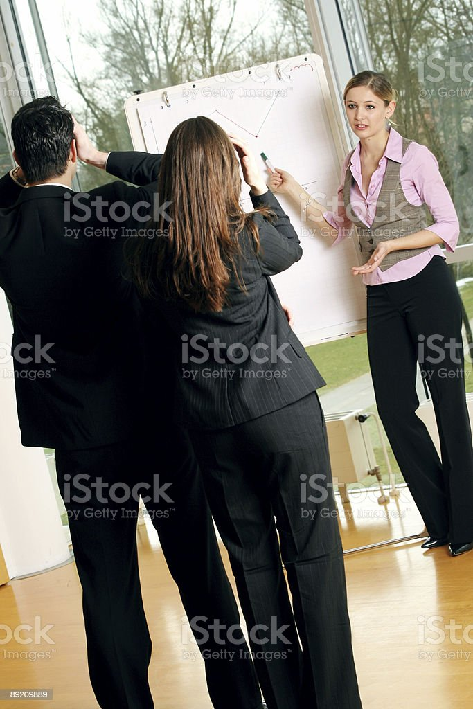 business team on a chart royalty-free stock photo