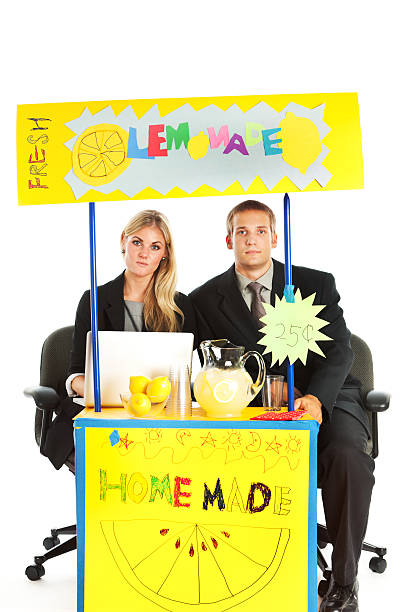 Business Team Partners, New Venture Entrepreneurs Making Lemonade Stand Sales Subject: Business partner team entrepreneurs managing a children's lemonade stand. A metaphor for business management and administration. lemonade stand stock pictures, royalty-free photos & images