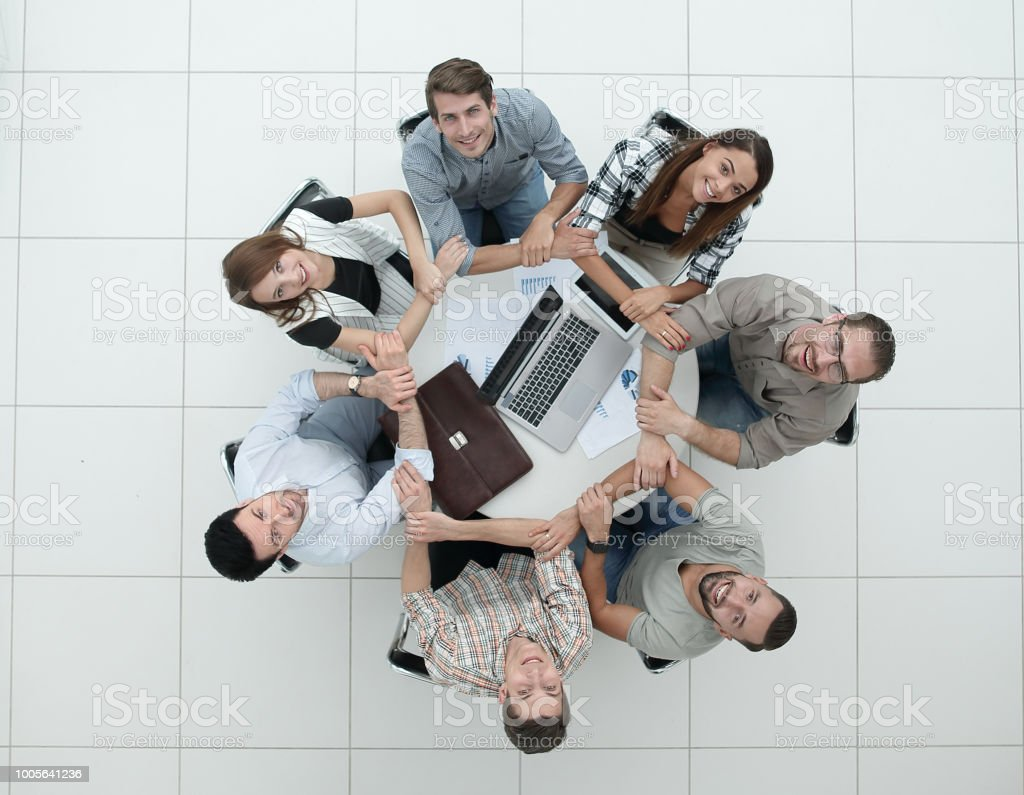 Business team people join hands forming circle stock photo