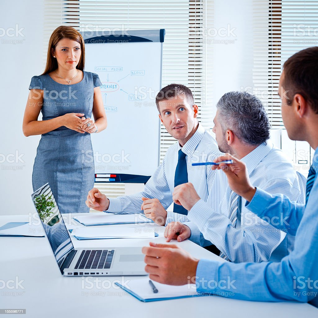 Business team Businness team discussing a strategy of their company in a board room. Adult Stock Photo