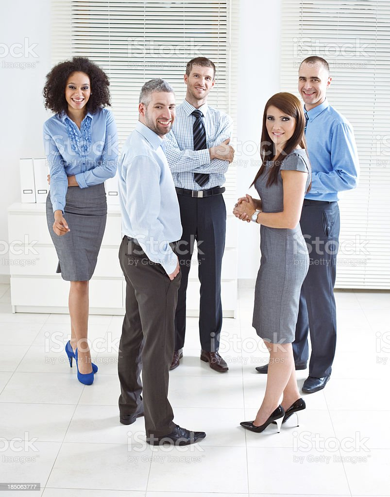 Business Team Five confident business people standing in an office and smiling at camera. 25-29 Years Stock Photo