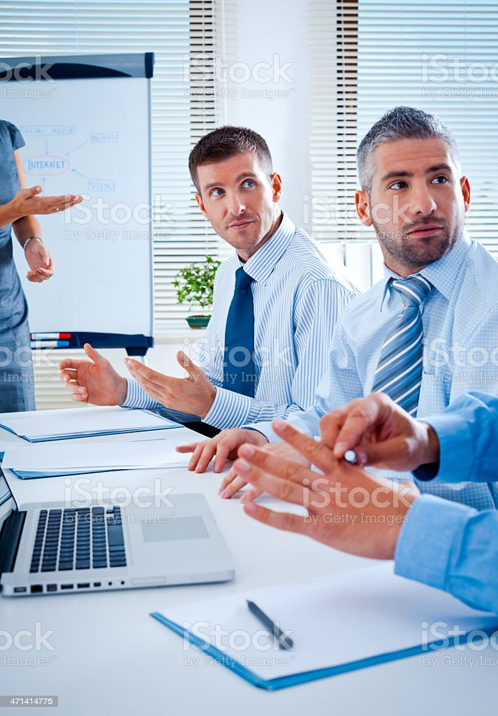 Business team Businness team discussing a strategy of their company in a board room. 30-34 Years Stock Photo