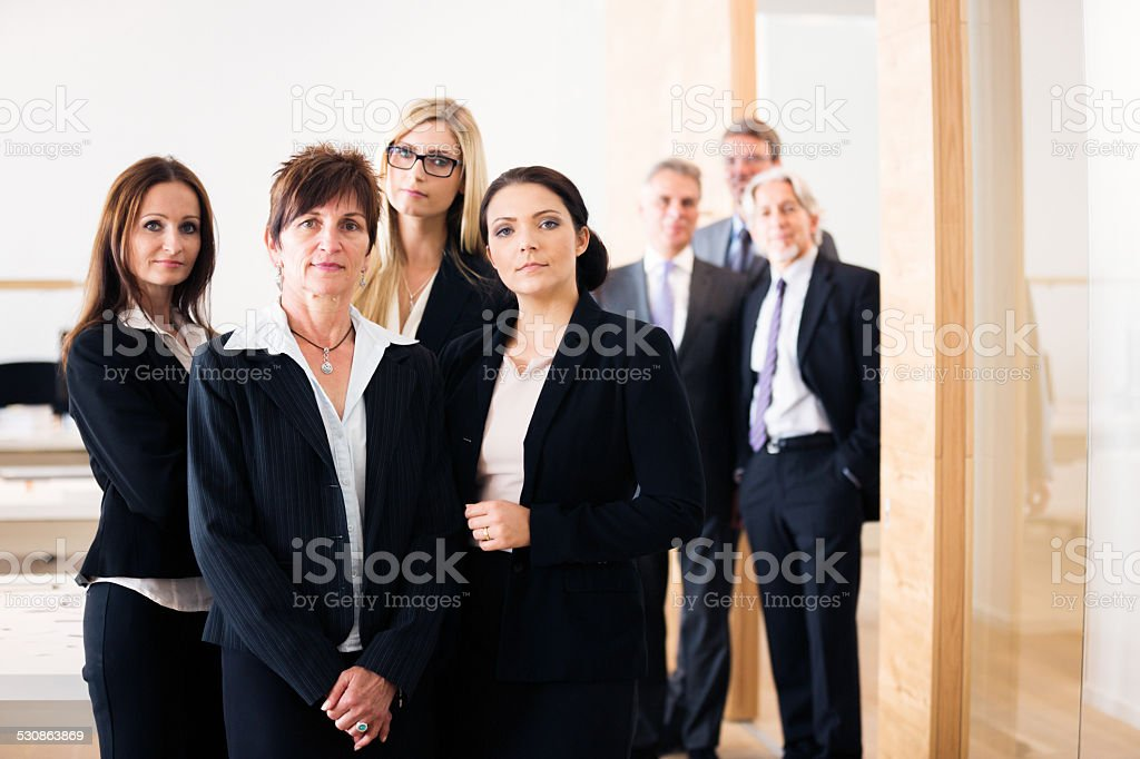 business team posing for a group shot stock photo